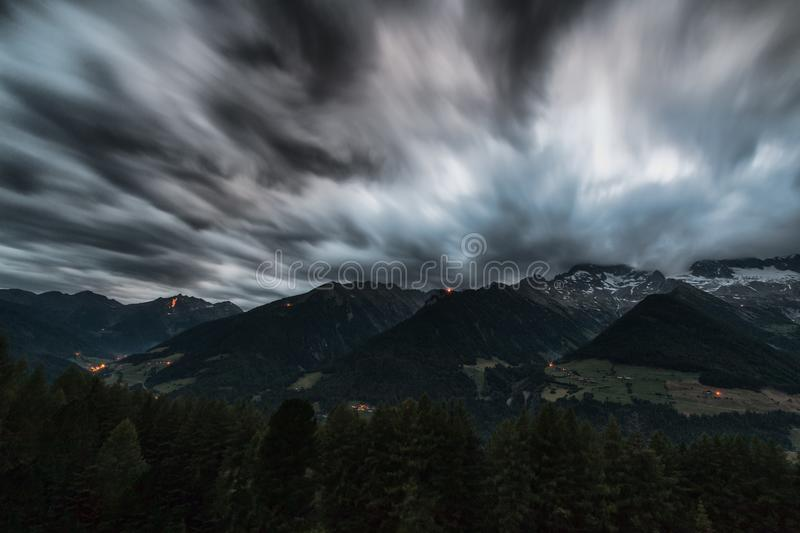 Time Lapse Photography of Pine Trees Near Mountains Under Grey Clouds royalty free stock photo