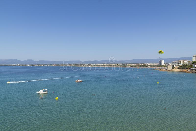 Sea of Salou, Spain. Busy coastline and beach at summer stock image