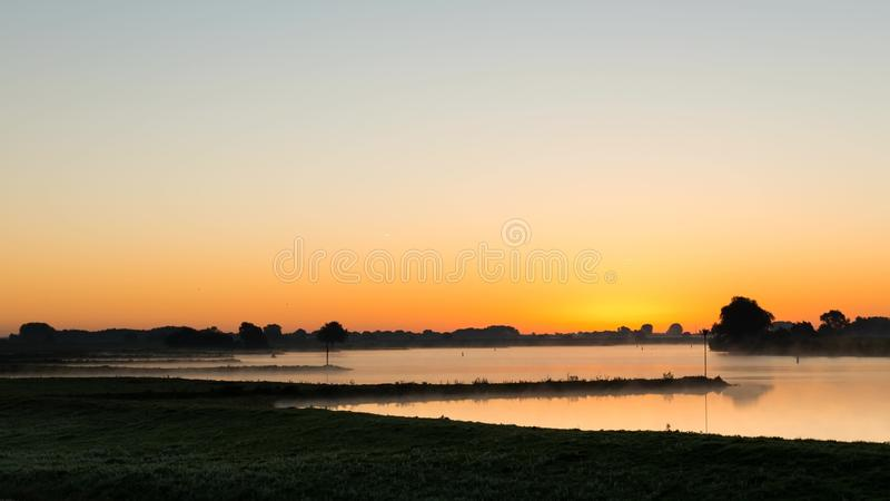 Time lapse of sunrise in Culemborg, the river Lek. Time lapse of the sunrise at the river Lek with boats near Culemborg, The Netherlands stock footage