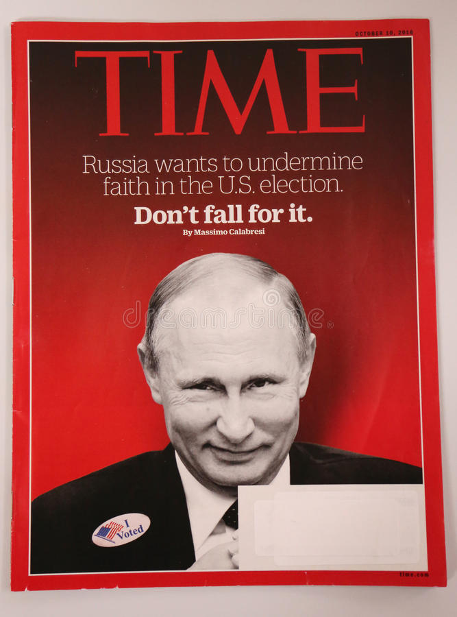 Time magazine with Vladimir Putin on front page issued before 2016 Presidential election. BROOKLYN, NEW YORK - DECEMBER 18, 2016: Time magazine with Vladimir stock images