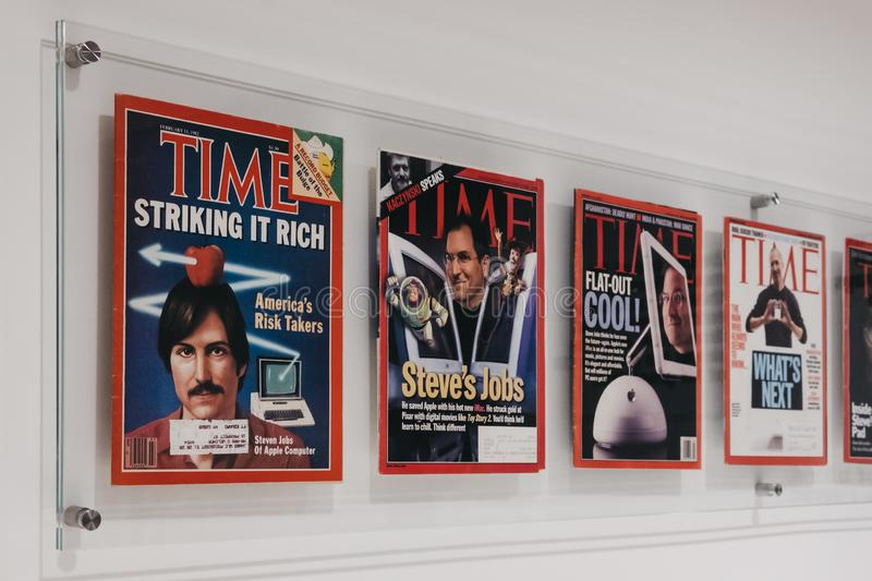 Time magazines with Steve Jobs on the cover inside Apple Museum in Prague, Czech Republic. Prague, Czech Republic - August 28, 2018: Time magazines with Steve royalty free stock photography
