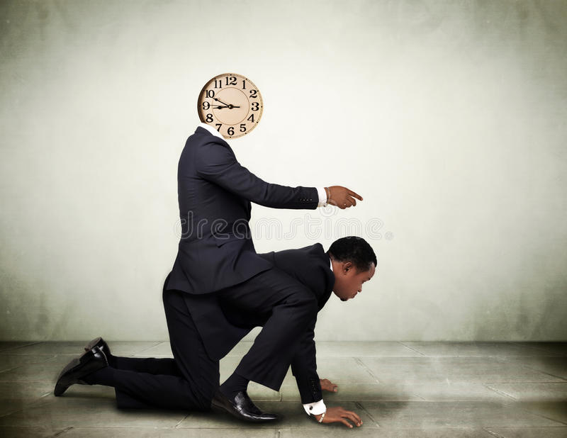Time management concept. Businessman controlled by time. Time management concept royalty free stock photo