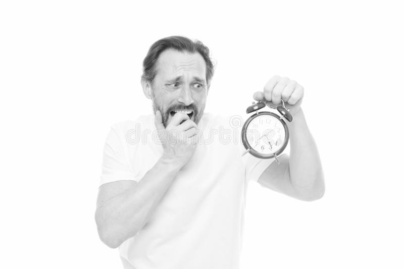 Time management and discipline. Punctuality and responsibility. Man with clock on white background. Hate being late. Man stock photography