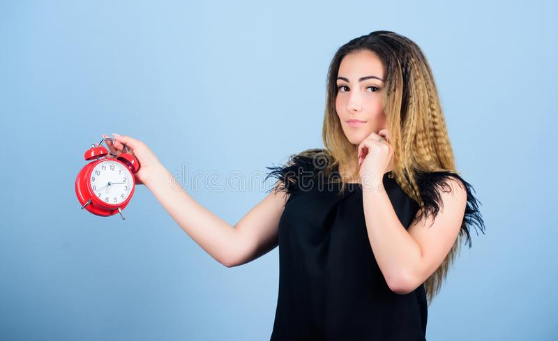 Time management. Punctuality and discipline. Woman hold red alarm clock. Counting time till deadline. Pretty girl stock photos