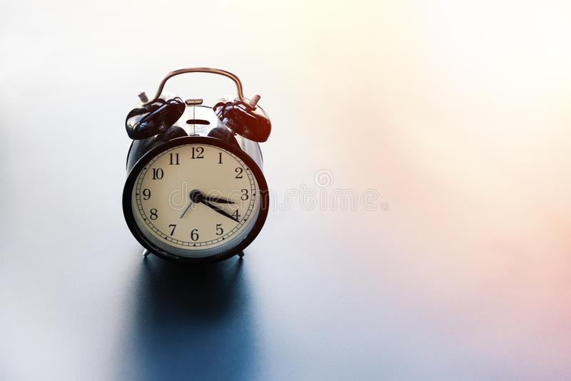 Time management, work life balance concept, alarm clock with copy space royalty free stock photos