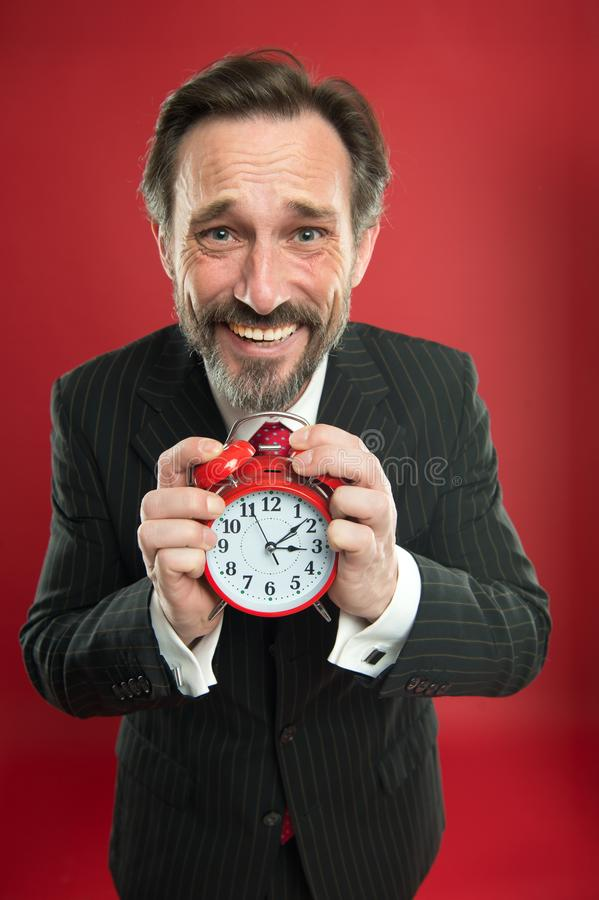 Time is merciless. Businessman formal suit hold alarm clock. Deadline concept. Last minute. Time management. Schedule stock photography