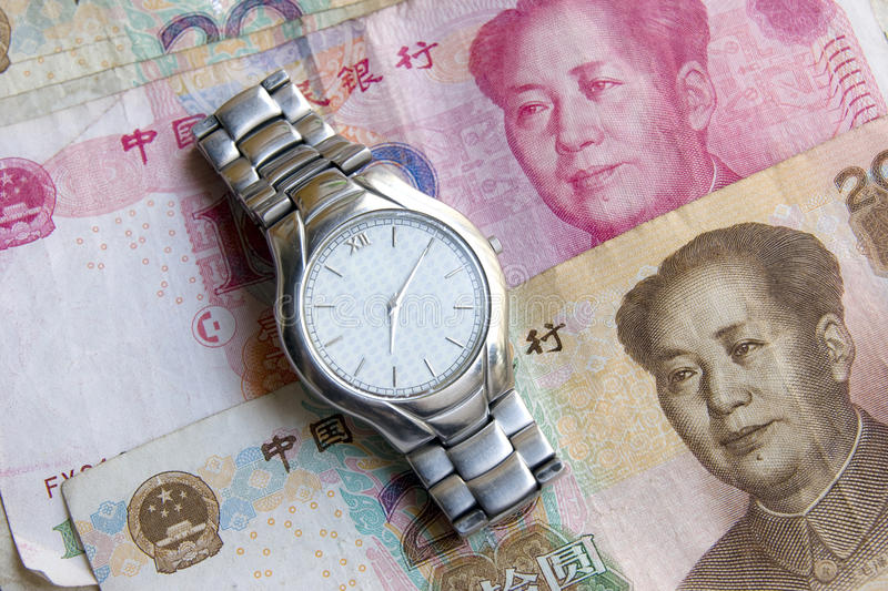 Time is money. Time is oney concept。A wrist watch on money background stock images
