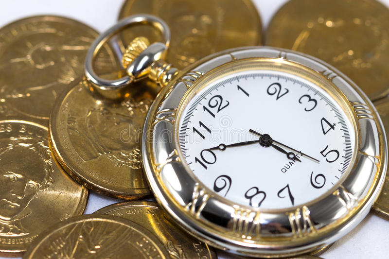 Time is money. Golden watch around U.S. coins (time is money concept stock photos
