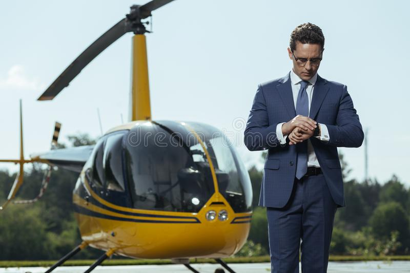 Successful young CEO waiting for a helicopter ride stock image