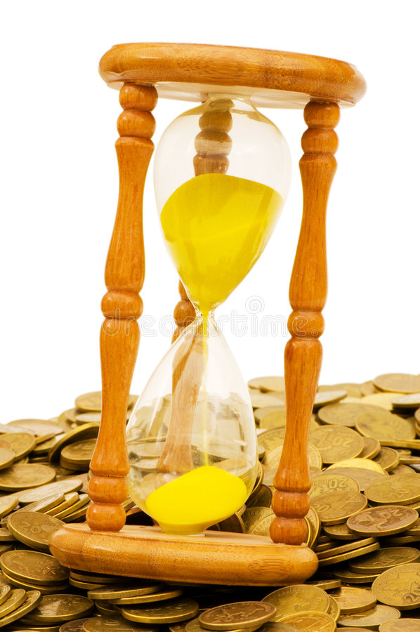 Time is money concept. Hourglass and coins stock photography
