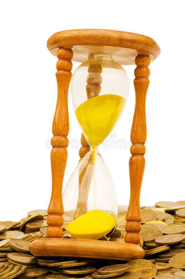 Time is money concept. Hourglass and coins royalty free stock image