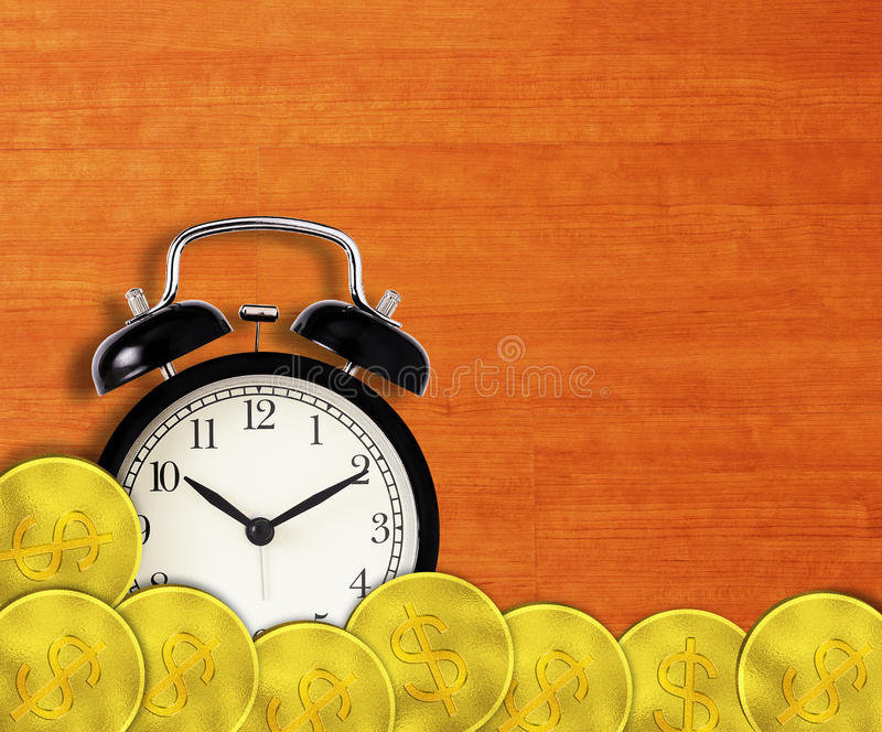 Time is Money Concept. Alarm clock and gold coin stock photo