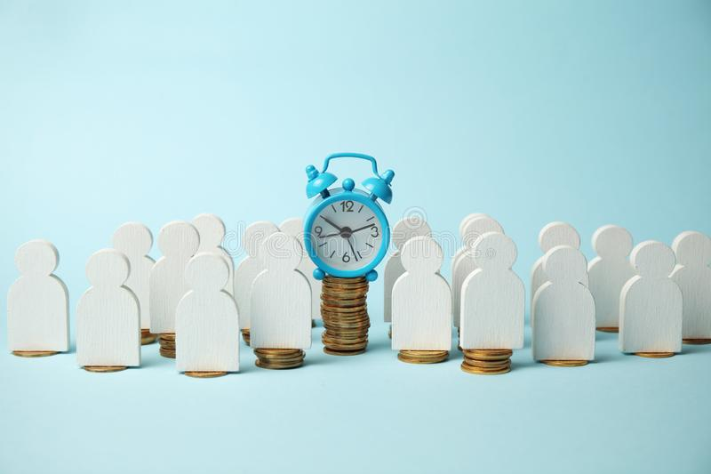 Time is money concept. Alarm clock and golden coins. Financial option of cash investment royalty free stock photo