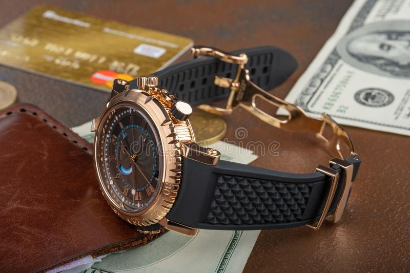 `Time is money` concept, credit card, Wrist Watch, purse, 100 dollars banknote. `Time is money` concept, credit card, Wrist Watch with roman dial, purse, 100 stock photos
