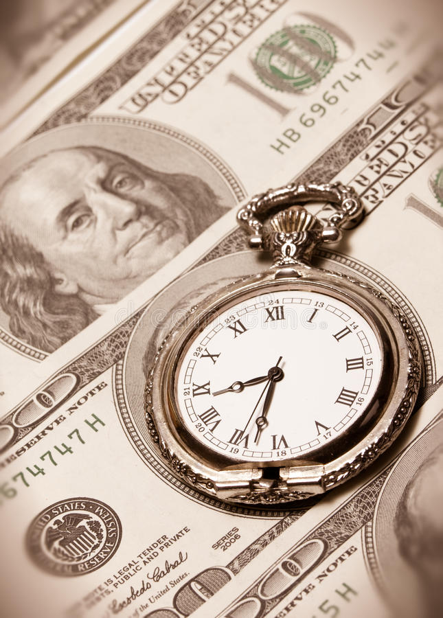 Time and money concept image - pocket watch and US. Time and money concept image - old silver pocket watch and US currency isolated on white stock photos
