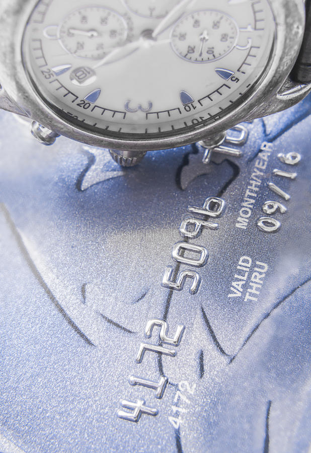 Time is money. Credit cards and a watch up close royalty free stock photography