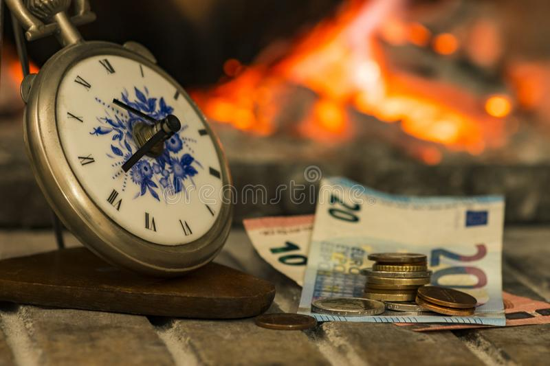 Time is money, fire is close. Time is money beside the fire, banking situation, bankruptcy, athens, greece stock image