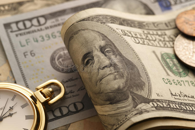 Time and Money. Gold Tone. Close up - Stock Image. Time is money. Gold Tone. Close up stock photography