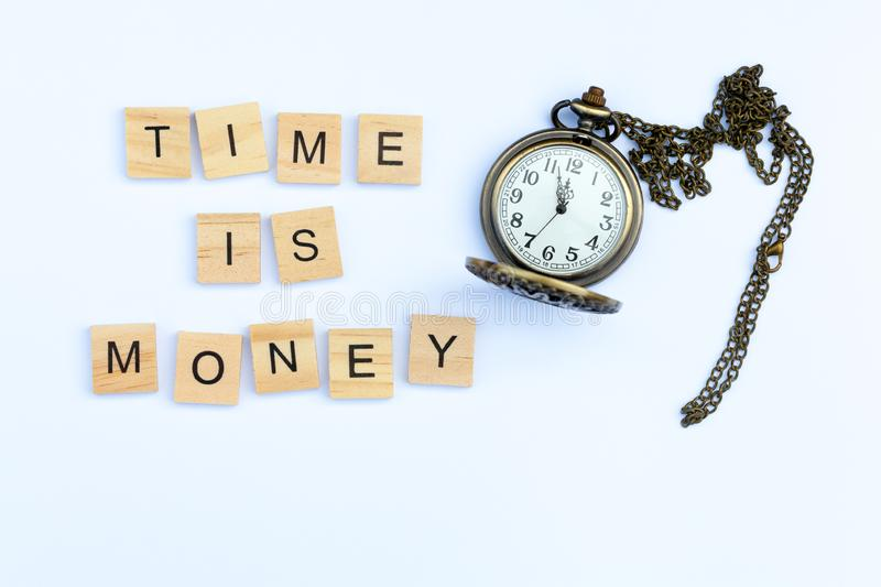 Time is Money with an old fashioned pocket watch. The words `time is money` on a white background with an old fashioned pocket watch royalty free stock images