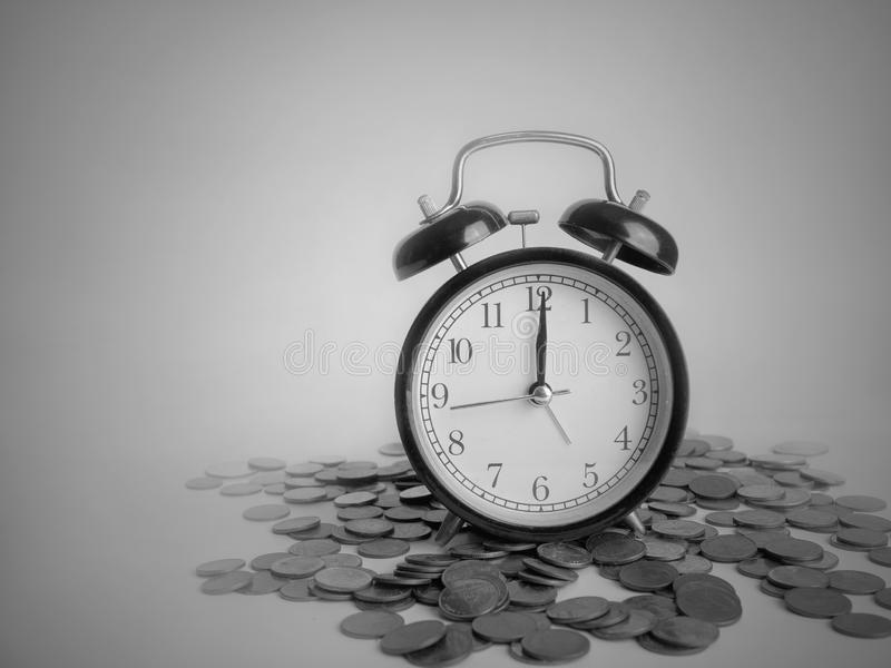 Time is Money, save time save money in black and white.  stock photo