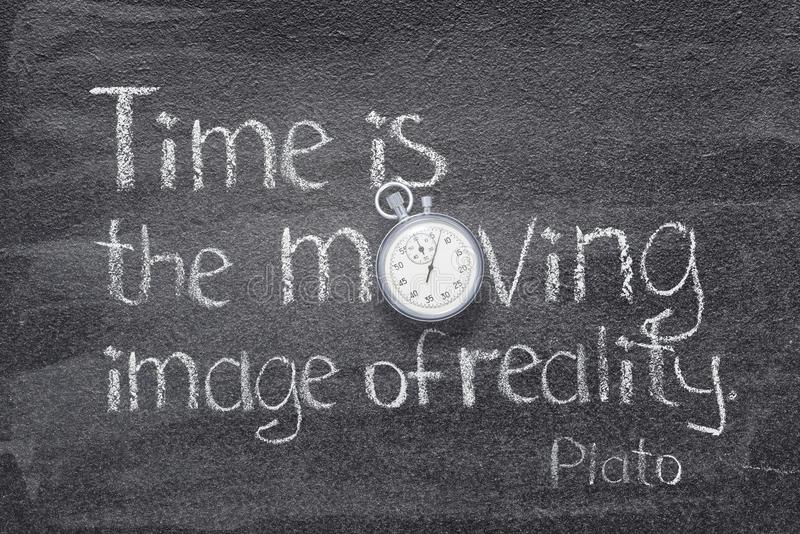 Time moving image. Time is moving image of reality quote of ancient Greek philosopher Plato written on chalkboard with vintage stopwatch instead of O royalty free stock images