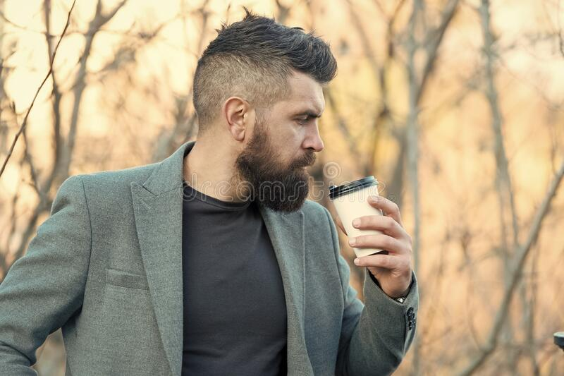 Time for myself. Hipster hold paper coffee cup. Relaxing coffee break. Businessman bearded guy drink coffee outdoors royalty free stock images