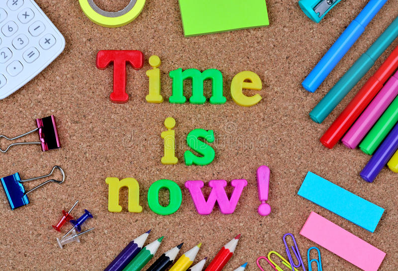 Time is now words on cork. Background stock images