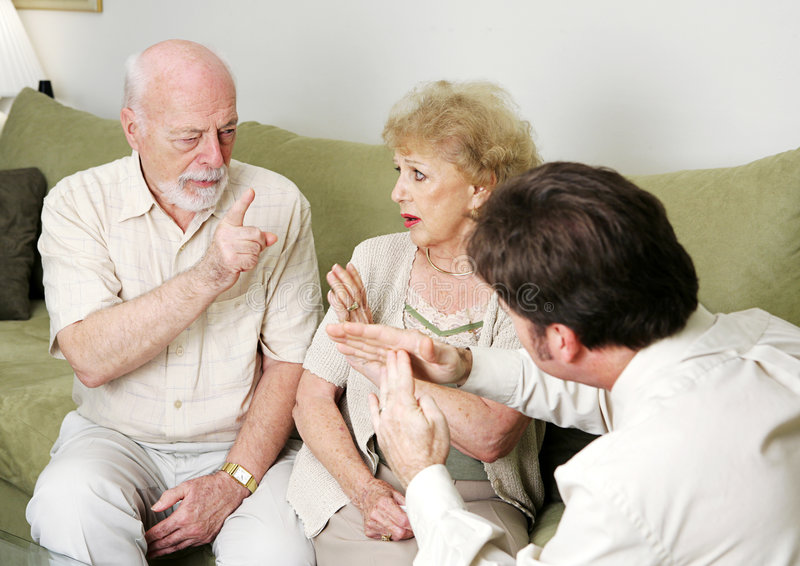 Time Out From Fighting. A bickering senior couple in the marriage counselor's office. He is calling a time-out