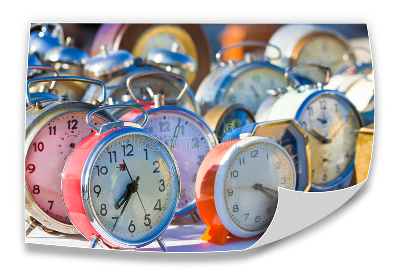 Time passes inexorably - Old colored metal table clocks - concept image stock photos