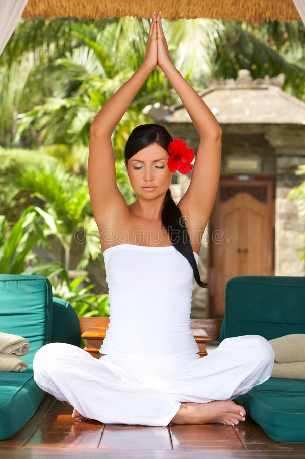 Time for relax. 20-25 years woman portrait during yoga at exotic surrounding, bali indonesia