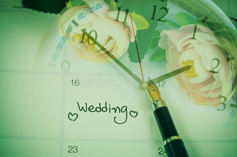 Time for Reminder Wedding day in calendar planning and fountain pen. With color tone royalty free stock images