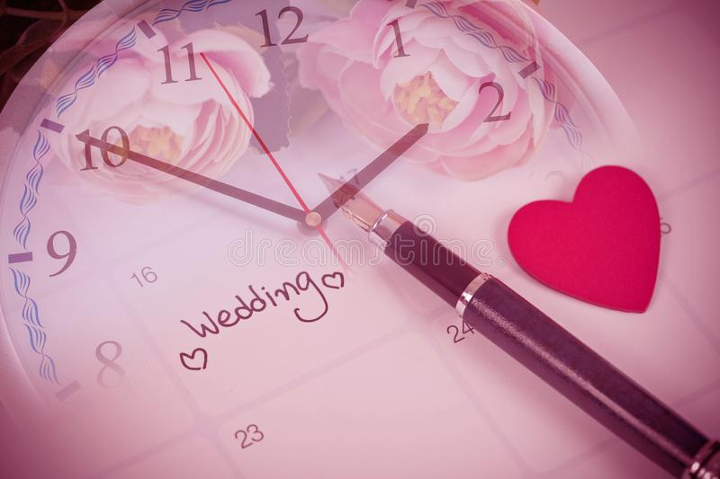 Time for Reminder Wedding day in calendar planning and fountain pen. With color tone stock photos