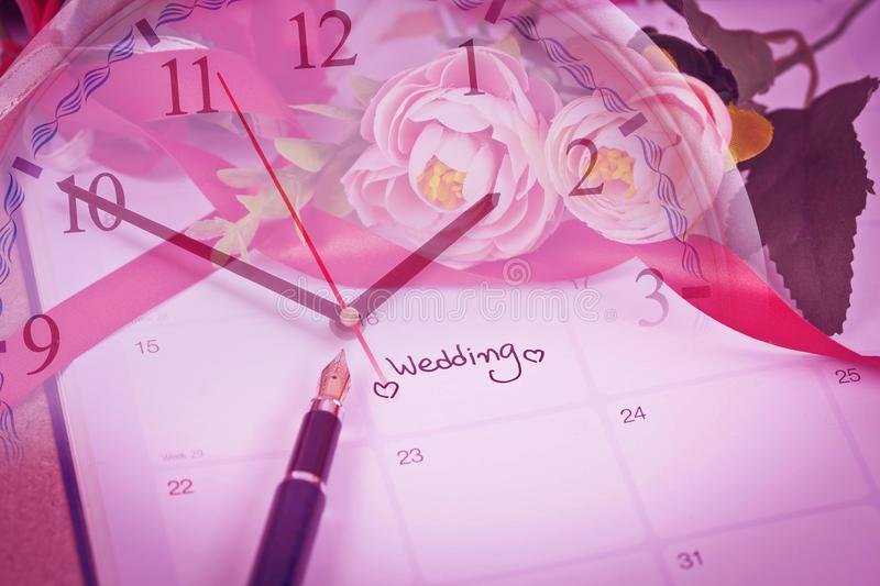 Time for Reminder Wedding day in calendar planning and fountain pen. With color tone stock images