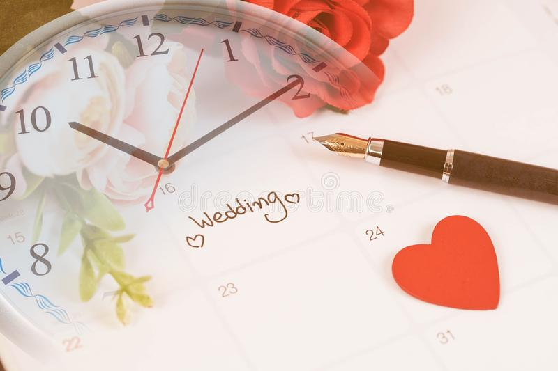 Time for Reminder Wedding day in calendar planning and fountain pen. With color tone royalty free stock photos