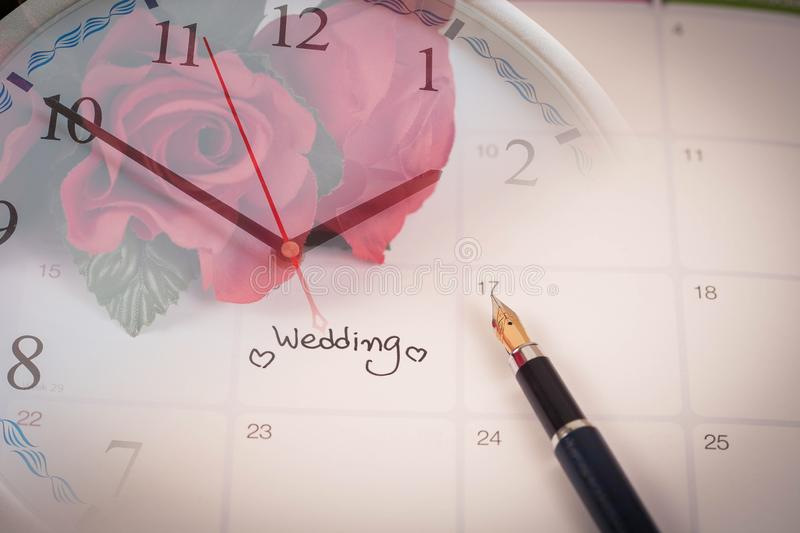 Time for Reminder Wedding day in calendar planning and heart sign. Time for Reminder Wedding day in calendar planning and fountain pen with color tone stock photo