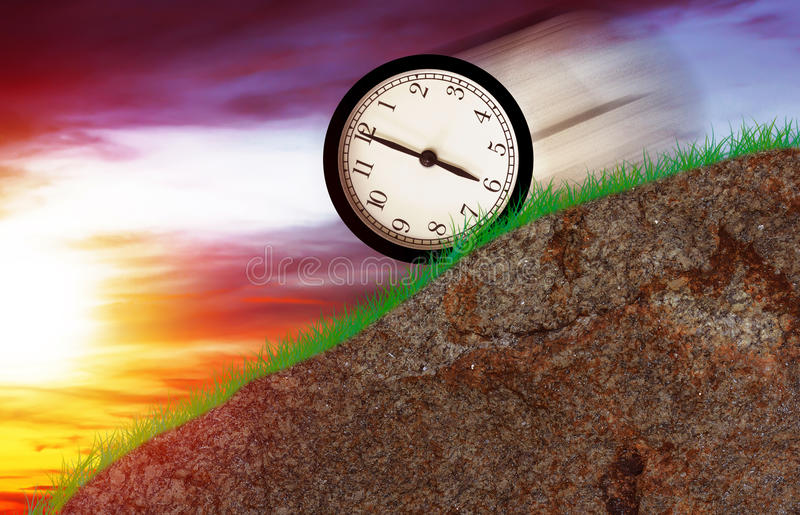 Time Running Concept. Time concept, clock moving down the hill royalty free stock photo