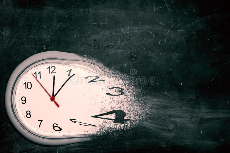 Time is running out concept. Shows clock that is dissolving away into little particles stock image