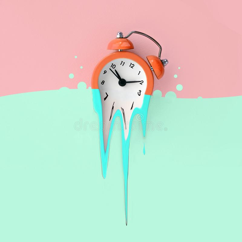 Time is running out. Melted blue alarm clock royalty free stock photography