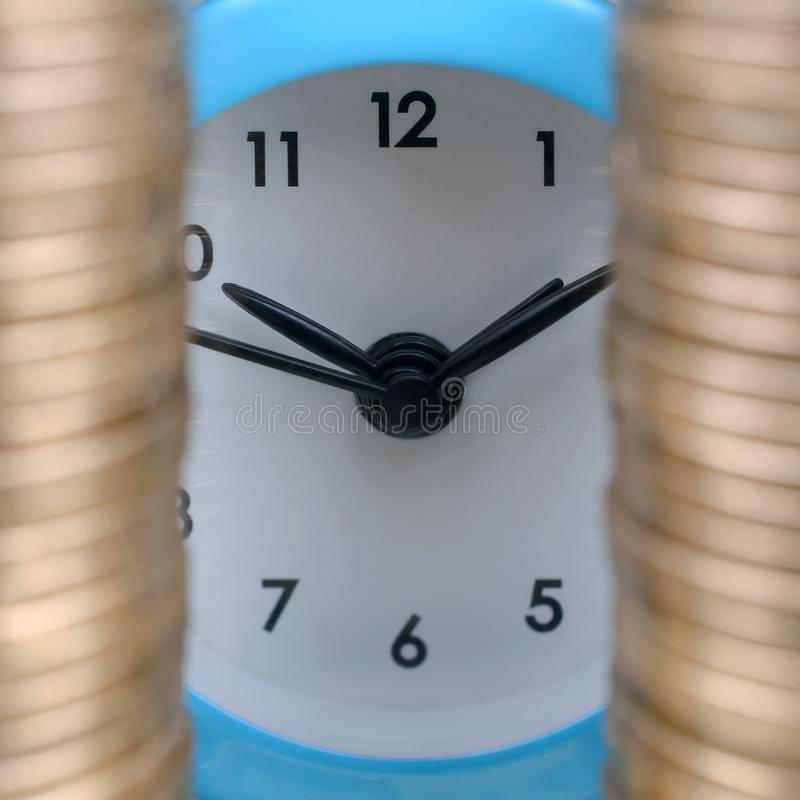 Time for savings money concept, banking and business idea. Alarm clock and Money coin stacks. Finance sustainable development and economic growth stock photography