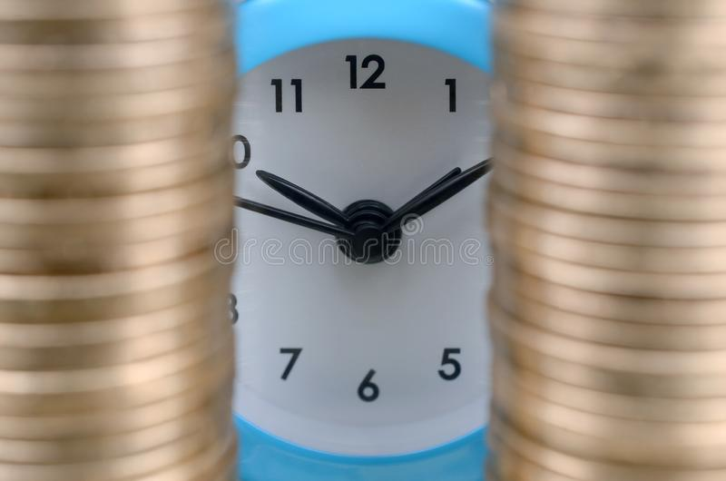 Time for savings money concept, banking and business idea. Alarm clock and Money coin stacks. Finance sustainable development and economic growth royalty free stock image
