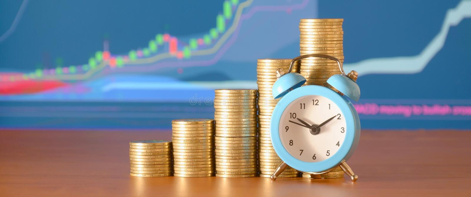 Time for savings money concept, banking and business idea. Alarm clock and Money coin stacks in grow graph. Finance sustainable development and economic growth stock photo