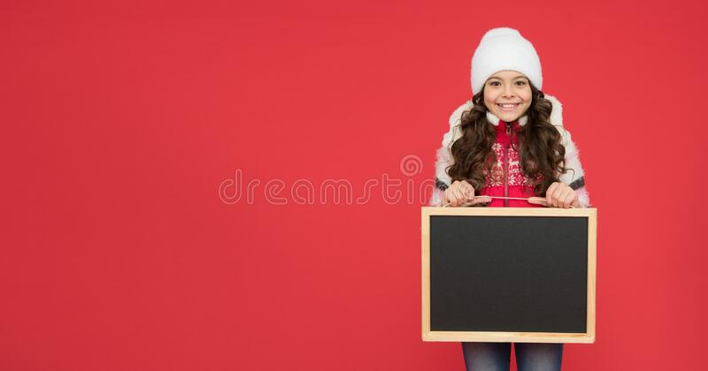 Time for school holiday. winter shopping sales. announcement board. very profitable proposition. happy girl empty stock image
