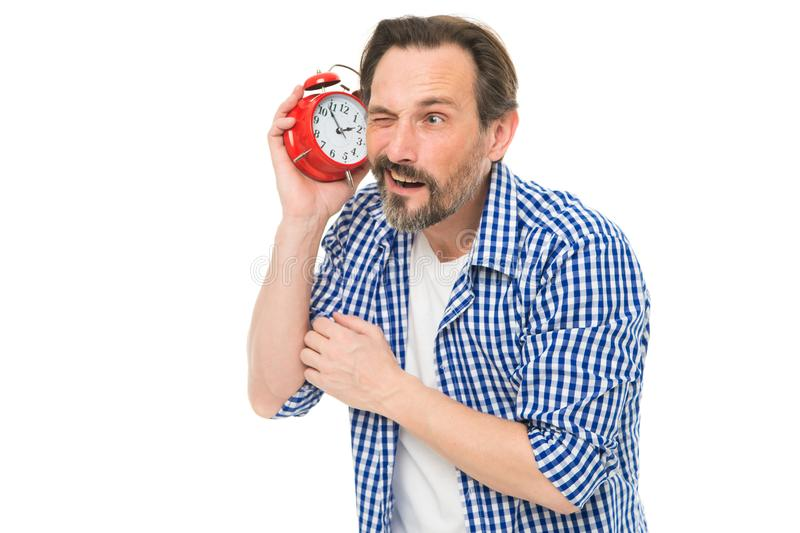 Time is short. Bearded man listening to clock ticking sound. Aged man holding alarm clock. Mature man with mechanical. Clock in hand. Senior timekeeper with royalty free stock photography