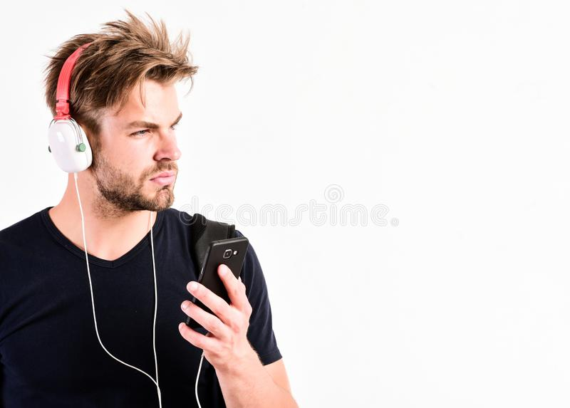 Time stops with nice music. new technology in modern life. sexy muscular man listen music. man listen new song isolated royalty free stock image