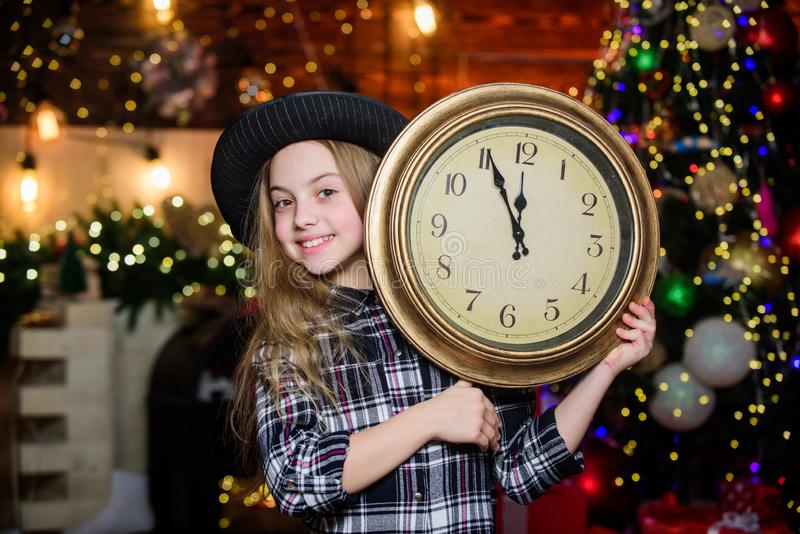 Time to celebrate. Happy new year. cowgirl child with big clock. Xmas tree. Happy holiday. Little girl in cowboy hat stock image