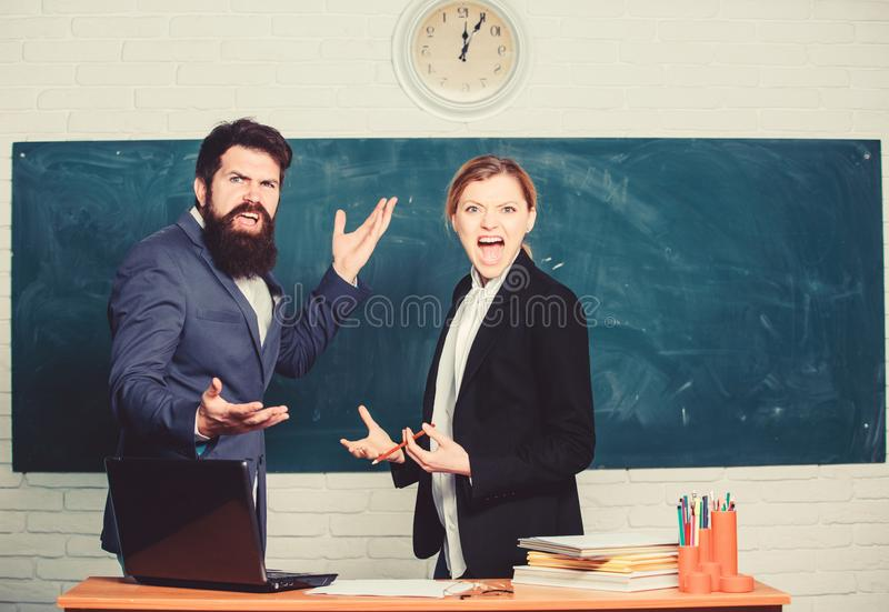 Time to chill. paper work. office life. teacher and student on exam. back to school. Non-formal education. business. Couple use laptop and document. businessman stock image