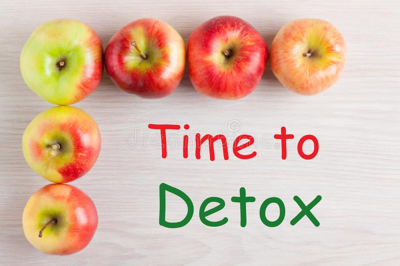 Time To Detox. Frame of apples with text Time To Detox on wooden surface. Top view stock image