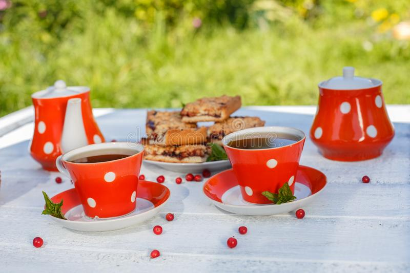 Time to drink tea outdoors in the garden. Summertime scene.  royalty free stock photo