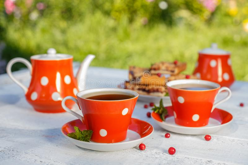 Time to drink tea outdoors in the garden. Summertime scene.  stock photo