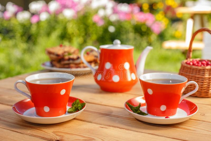 Time to drink tea outdoors in the garden. Summertime scene.  stock photography